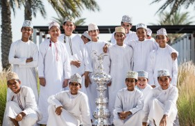 The Americas Cup Trophy in Muscat, Oman. Shown here with a group of local schoolboys to celebrate and highlight The Louis Vuitton Americas Cup World Series coming to Oman in February 2016. Image licensed to Lloyd Images